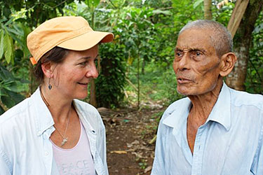 Gail meets with a cacao farmer