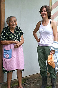 Gail stands with a cacao farmer